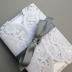 wrap invitations in a doily & tie with a ribbon :)