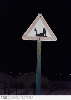 mermaid street sign