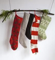 no mantle?  hang stockings on a branch!  wish I had thought of this before!