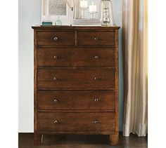 Valencia Tall Dresser #potterybarn-  We have antique tall highboy dresser with tiger striping and ornate dark brass (black) pulls.