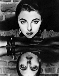 Joan Collins and her reflection, 1952. Photo by Cornel Lucas