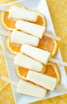 Homemade Orange Creamsicles- 1 cup orange juice, 1 cup coconut milk, 3 TSP honey, 1/4 tsp orange extract, 1/2 tsp vanilla extract Whisk all ingredients together. Pour mixture into popsicle molds. Freeze for 4-6 hours or until frozen.