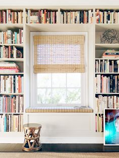 Bookshelves frame a window | Why It Works: A Creative Director's Small Space Home via @MyDomaine