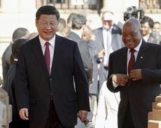 Chinese President Xi Jinping walks with South African President Jacob Zuma on arrival at the Union Buildings in Pretoria , December 2, 2015.    REUTERS/Sydney Seshibedi - RTX1WUI9