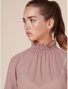 c7f341083b3e77 This sheer blouse that works better than cupid s arrow.