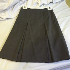 J. Crew Gray Wool Skirt This is perfect for fall into winter. Has front pleats with front pockets. Zipper back. Can wear with boots for more of a casual look or with heels. In perfect condition! J. Crew Skirts