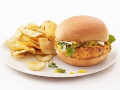 Salmon-Apple Burgers : Make your own relish by simmering sliced Golden Delicious apples in cider, vinegar and curry — then pile it on top of this salmon burger. The fresh fruit flavor keeps the fish light. Apple Recipes, Salmon Recipes, Fish Recipes, Seafood Recipes, Healthy Burger Recipes, Fast Healthy Meals, Healthy Eats, Easy Meals, Food Network Recipes