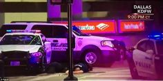 A gunman named Micah X. Johnson was killed after a four-hour standoff with police. Before being killed, he told a hostage negotiator that he wanted to kill white police officers. Above, a police officer lies stricken next to cop cars