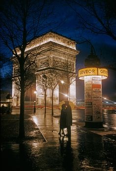 """Young lovers embrace beside the Arc de Triomphe in Paris, 1960.Photograph by Thomas Nebbia, National Geographic Creative """""""
