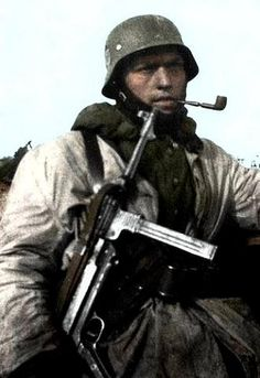 German soldier with mp 40 and pipe. So German!! :-) FUR DAS VATERLAND!!!!!