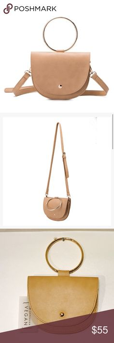 Simply Elegant & Brand New Accent Handle Crossbody This handbag is made of premium vegan leather and handcrafted by a designer that won  the PETA Vegan Fashion award for best animal friendly accessories in 2016! Features both a front and back magnetic flap closure. Wear this item to complete your outfit with a bold accessory while carrying your important belongings like your money, lipstick, cards, and smartphone. Comes with a removable strap giving you the option to wear as a handbag or…