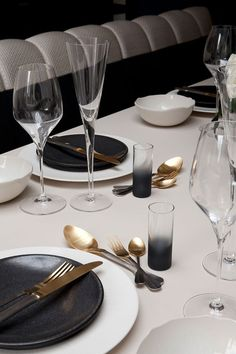 Table setting detail in an apartment on the King's Road designed by Rachel…
