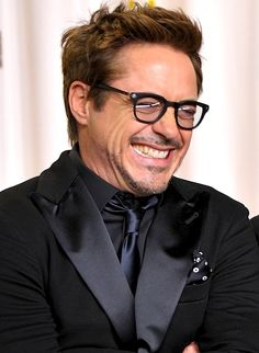 Robert Downey Jr. giggling, Oscars 2013. This is the suit I want the men to wear in my wedding!!
