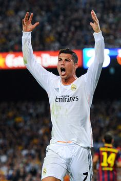 Cristiano Ronaldo of Real Madrid CF argues with the referee after being brought down during the La Liga match between FC Barcelona and Real Madrid CF at Camp Nou on October 26, 2013 in Barcelona, Catalonia.