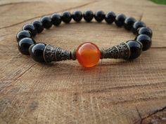 Check out this item in my Etsy shop https://www.etsy.com/listing/234400128/carnelian-mala-guru-bead-mala-black-onyx