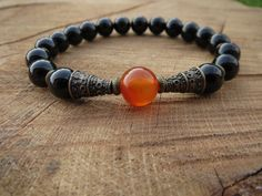 Check out this item in my Etsy shop https://www.etsy.com/listing/234400128/carnelian-mala-guru-bead-mala-black-onyx