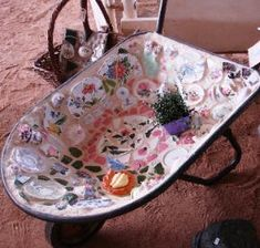 Mosaic wheelbarrow- I want to do this and than make it a fish pond!!