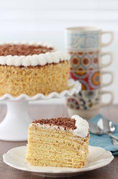 Smetannik is a Russian cake that has multiple thin and fluffy cake layers with a tangy and sweet sour cream frosting. The cake is so tender and delicate, it just melts in your mouth. Sour Cream Frosting, Cream Cake, Round Cake Pans, Round Cakes, Russian Cakes, Russian Desserts, Russian Recipes, Cake Recipes, Dessert Recipes