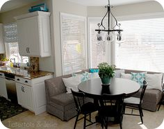 I love the black table with the black & white banquet seating. Check out the post for her complete kitchen remodel.