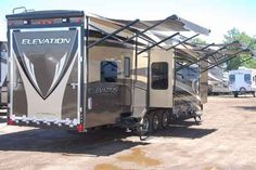 """2015 New Crossroads Elevation Las Vegas TF38LV Toy Hauler in Michigan MI.Recreational Vehicle, rv, 2015 CrossRoads Elevation Las Vegas TF38LV, Free Shipping First 1,000miles Only $609.74 per month with approved credit! Forget what you know about """"toy haulers"""". The elevation is not just for those who haul quads, dirt bikes, and motorcycles. Smart design and floorplan innovation enable Elevation to excel at delivering multi-zone living, sophistication and your own personal style, wether you…"""