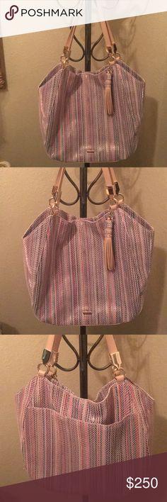 Gorgeous Brahmin handbag Wow Sale! Brahmin striped handbag with tassel. Does have some lipstick stains. Brahmin Bags Shoulder Bags