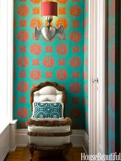 A winged sconce by Blackman Cruz adds a whimsical touch to the hallway, with its custom-made Gracie wallpaper.