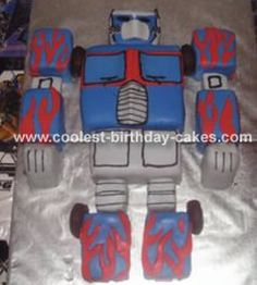 Optimus Prime Cake: I baked two huge sheet cakes, one vanilla and one chocolate for this Optimus Prime cake. Then on a large piece of butcher block paper I drew out the body,