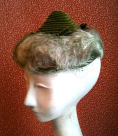 Vintage 1950s 1960s Trebor Original Sculpted  Cone Hat with feathers size M. $55.00, via Etsy.