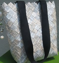 Product: Book Bag  Company: gogreenitems.com  -This bag is made from recycled white pages! Totally cute. Use it for books, as a purse or anything else! It's a nice tote and eco-friendly! #greendorm