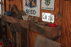 We used an old barn beam on our porch to hold some of our antiques.  The wooden cane is the memory of my father in law.