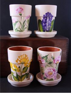 flower pots outdoor Beautifully hand-painted set of four clay herb flower pots with matching saucers. Each pot comes wrapped in a cellophane bag tied wit Painted Clay Pots, Painted Flower Pots, Hand Painted, Terra Cotta, Decorated Flower Pots, Flower Pot Design, Clay Flower Pots, Sympathy Flowers, Clay Pot Crafts
