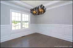 Formal dining room with trey ceiling, custom wainscoting, site-built hardwood flooring.