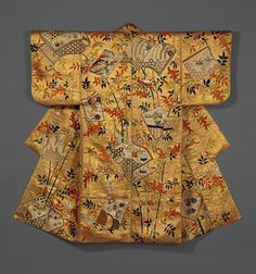 Noh costume (nuihaku) with books and nandina branches, Edo period (1615–1868), second half of 18th century  Japan  Silk embroidery and metallic leaf on silk satin