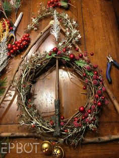 Here's a quick craft I left out of my Party posts, but I think you guys might like: I made a Deathly Hallows wreath! Someone shar. Harry Potter Christmas Decorations, Harry Potter Christmas Tree, Hogwarts Christmas, Xmas Decorations, Deco Noel Harry Potter, Harry Potter Decor, Classy Christmas, Christmas Holidays, Christmas Wreaths