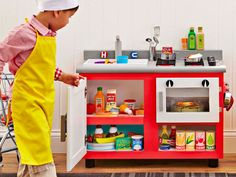 Brought to you by Lowe's Creative Ideas. Turn a stock cabinet and everyday materials into a kid's kitchen that's sure to entertain for years to come. It's easy to build, so start spoiling your little ones today! Diy Kids Kitchen, Mini Kitchen, Cute Kitchen, Kitchen Corner, Toy Kitchen, Wooden Kitchen, Kids Corner, Kitchen Ideas, Kitchen Design
