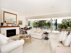 Open plan living room using white colours with carpet & bi-fold doors - Living Area photo 1275027