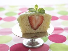 Strawberry-Lime Stuffed Cupcakes : While they may look innocent enough on the outside, these jumbo vanilla cupcakes are anything but ordinary. Stuffed with a fresh strawberry and topped with lime frosting, this dessert is fun to make and eat.