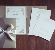 Beautiful wedding invitation with vintage edwardian details, in a gold pocket wallet and hand-tied satin ivory bow.