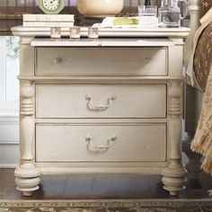Three-drawer nightstand with a pull-out shelf and sliding jewelry tray. Includes power outlet and charging station.Product: Night...