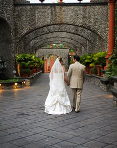 bride and groom walking Zephyr Palace | Modern Elegance - Zephyr Palace Costa Rica