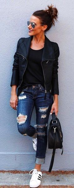 #winter #outfits  black zip-up jacket with distressed blue denim jeans