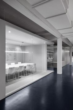 Canadian designer Anne Sophie Goneau has transformed part of an old building into a minimalist workspace for a tech company.