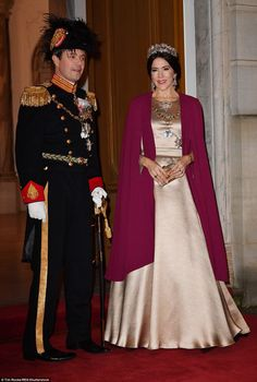 Ringing in 2017: Mary, who dressed in a floor-length gold gown and plum cape, was joined b...