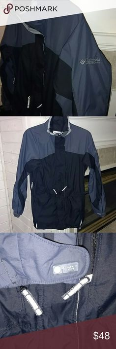 WOMAN'S NAVY & BLACK COLUMBIA WINTER COAT Excellent Condition Worn very little Zippered Pockets all over  Breathable Mesh Panel's Inside Neutral Color of Navy & Black Toggle Neck & Toggle Waist band Waterproof material Columbia Jackets & Coats Utility Jackets