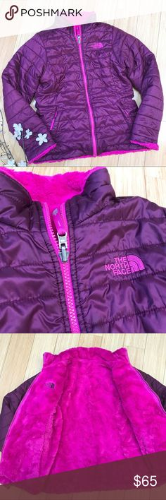 GIRLS North Face reversible winter jacket, M 10/12 Gorgeous reversible the North Face winter jacket coat, size girls medium 10/12. Maroon on the outside and fuzzy pink on the inside, both sides are reversible, zippered pockets. This is in excellent condition, just a tiny bit of wear on the cuff fur. Otherwise perfect. Length of jacket is 20.5 inches, sleeve length 21.5 inches. Super nice! The North Face Jackets & Coats Puffers