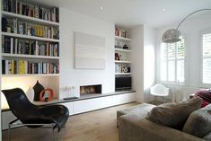 Decorative Bookcase And Minimalist Fireplace For Modern Family Room Design Ideas With SImple Furniture Layout