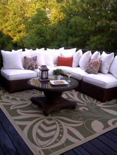 Love this look. Along the same lines as how I want our deck to look- with the L sectional seating in the corner. Love the white here, but no way I would choose white around our munchkins. Love the rug too.