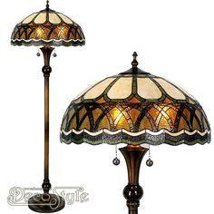 Tiffany Vloerlamp Arithiel  Een bijzonder mooie vloerlamp. Helemaal met de hand gemaakt van echt Tiffanyglas. Dit originele glas zorgt voor de warme uitstraling. De voet is vervaardigd van bronskleurig metaal. Met 3x grote fitting (E27). Met schakelaar aan de kap. Afmetingen: Hoogte: 164 cm Diameter Kap: 56 cm