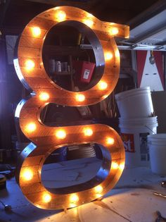 Serified G Marquee Light by Scott Coppersmith Designs.