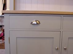 It has been painted in a cool mid gray, CABINETS-Farrow & Ball No 5 Hardwick White (exterior) and a contrasting lighter colour, No 2004  Slipper Satin (interior).